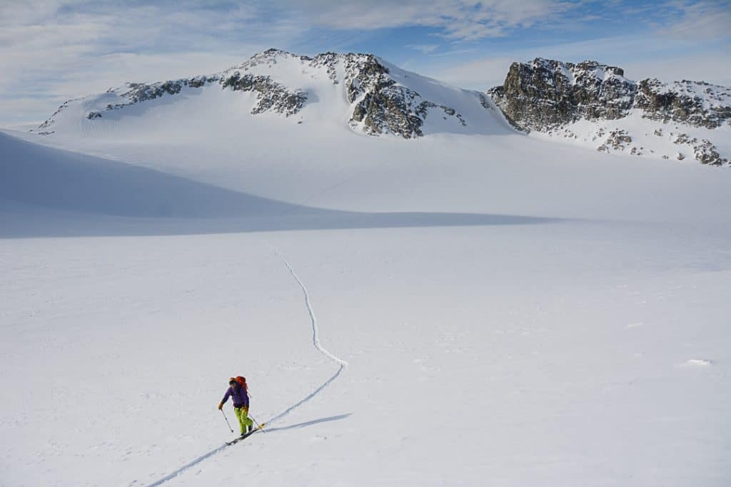 Ascending Tremor Glacier, Mount Pattison in the Background on the Spearhead Traverse